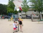 Alicia and the boys at the camp playground
